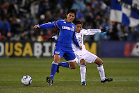 Roger Espinoza (blue) holds off Andy Najar...Kansas City Wizards defeated D.C Utd 4-0 in their home opener at Community America Ballpark, Kansas City, Kansas.