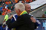 02 May 2015: Carolina head coach Colin Clarke (NIR) (in blue) and Tampa Bay head coach Thomas Rongen (NED) embrace before the game. The Carolina RailHawks hosted the Tampa Bay Rowdies at WakeMed Stadium in Cary, North Carolina in a North American Soccer League 2015 Spring Season match. The game ended in a 1-1 tie.