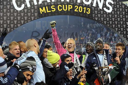 Dec 7, 2013; Kansas City, KS, USA; Sporting KC goalkeeper Jimmy Nielsen (in pink) celebrates with teammates after the 2013 MLS Cup against Real Salt Lake at Sporting Park. Mandatory Credit: Denny Medley-USA TODAY Sports