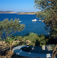 View from the garden to other islands and a fishing boat at anchor