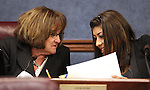 Nevada Assemblywomen Debbie Smith, D-Sparks, left, and Lucy Flores, D-Las Vegas, talk in committee at the Legislature in Carson City, Nev. on Tuesday, March 15, 2011..Photo by Cathleen Allison
