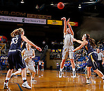 BROOKINGS, SD - OCTOBER 30:  Kerri Young #10 from South Dakota State University shoots over Jordan Needens #14 from South Dakota School of Mines in the first half of their exhibition game Thursday night at Frost Arena in Brookings. (Photo by Dave Eggen/Inertia)