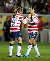 US midfielder Heather O'Reilly (9) gets a high five from teammate Carli Lloyd (10) after narrowly missing on a shot.  The U.S. Women's National Team tied Germany 1-1 in a friendly at Toyota Park in Bridgeview, IL on October 20, 2012.