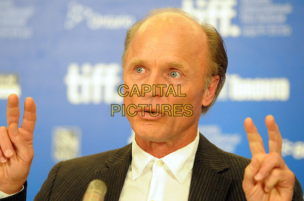 "ED HARRIS .""What's Wrong With Virgina"" Press Conference during the 2010 Toronto International Film Festival held at the Hyatt Regency, Toronto, Ontario, Canada, USA, 16th September 2010..portrait headshot white shirt hands finger gesture .CAP/ADM/BPC.©Brent Perniac/AdMedia/Capital Pictures."