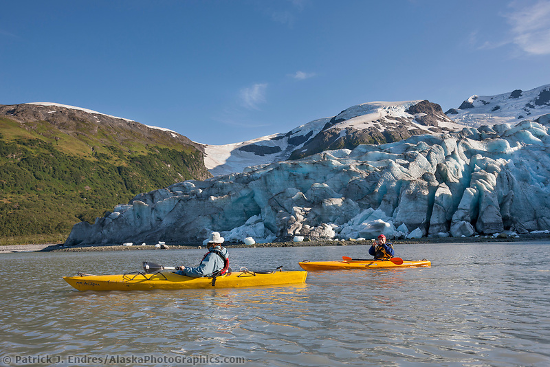 Kayakers explore the tidewater Harriman glacier, Harriman Fjord, Chugach mountains, Chugach National Forest, Prince William Sound, southcentral, Alaska.