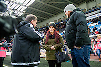 A woman proposes to a man during half time at the Barclays Premier League match between Swansea City and Southampton  played at the Liberty Stadium, Swansea  on February 13th 2016
