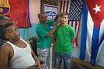 Havana, Cuba: Barber shop in Old Havana - with flags