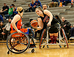MARSHALL, MN - MARCH 17:  Arinn Young #13 from Alabama controls the ball while being guarded by Morgan Wood #10 from the University of Texas Arlington during their championship game at the 2018 National Intercollegiate Wheelchair Basketball Tournament at Southwest Minnesota State University in Marshall, MN. (Photo by Dave Eggen/Inertia)