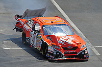 Jun 1, 2008; Dover, DE, USA; NASCAR Sprint Cup Series driver Tony Stewart pulls into his garage stall after crashing during the Best Buy 400 at the Dover International Speedway. Mandatory Credit: Mark J. Rebilas-US PRESSWIRE