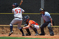 GCL Astros catcher Jake Bowey (21) at bat in front of catcher Jake Bowey and umpire Michael Boulianne during a game against the GCL Braves on July 23, 2015 at the Osceola County Stadium Complex in Kissimmee, Florida.  GCL Braves defeated GCL Astros 4-2.  (Mike Janes/Four Seam Images)