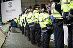 Police and stewards in front of the away support at Easter Road