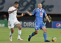 BOGOTÁ -COLOMBIA, 27-09-2014. Andres Cadavid (Der) jugador de Millonarios disputa el balón con Jorge Ramos (Izq) jugador de Fortaleza FC durante partido por la fecha 12 de la Liga Postobón II 2014 jugado en el estadio Nemesio Camacho el Campín de la ciudad de Bogotá./ Andres Cadavid (R) player of Millonarios fights for the ball with Jorge Ramos (L) player of Fortaleza FC during the match for the 12th date of the Postobon League II 2014 played at Nemesio Camacho El Campin stadium in Bogotá city. Photo: VizzorImage/ Gabriel Aponte / Staff
