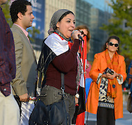 "October 23, 2011  (Washington, DC) Esraa Abdel Fatah (center), co-founder of the April 6 Youth Movement in Egypt, spoke to an assembly of October2011, the group that has been ""occupying"" Freedom Plaza in Washington.  During 2011, Esraa participated in the anti-Mubarak demonstrations that swept Egypt.  (center,left) Besam Fathy.   (Photo by Don Baxter/Media Images International)"
