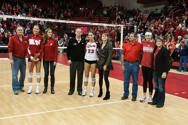 November 30, 2013:Morgan Broekhuis (12) with her parents Mike and Lisa, Kelsey Robinson (23) with her parents Mike and Sue, and  Hayley Thramer (17) with her parents Greg and Carm on Senior Day at the Devaney Sports Center in Lincoln, Nebraska.