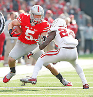 Ohio State Buckeyes tight end Jeff Heuerman (05) looks for running room after a short reception in the second half as Indiana Hoosiers cornerback Tim Bennett (24) tries to stop him at Ohio Stadium on 22, 2014. (Chris Russell/Dispatch Photo)