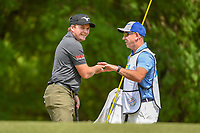 Eddie Pepperell (ENG) shares a laugh with his caddie after draining his putt on 1 during day 1 of the WGC Dell Match Play, at the Austin Country Club, Austin, Texas, USA. 3/27/2019.<br /> Picture: Golffile | Ken Murray<br /> <br /> <br /> All photo usage must carry mandatory copyright credit (© Golffile | Ken Murray)