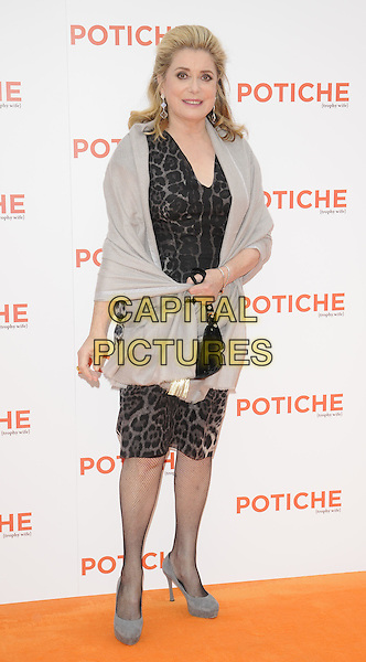 "Catherine Deneuve .At the UK Film Premiere of ""Potiche"", BFI Southbank, London, England, UK, .15th June 2011..full length grey gray wrap leopard print animal dress  black bag handbag shoes .CAP/CAN.©Can Nguyen/Capital Pictures."