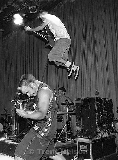 Bass player jumps from amp at Grimlock at the Tower Theater.<br />