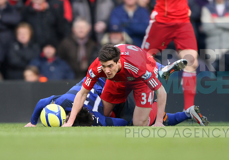 Liverpools Martin Kelly in action..Liverpool v Manchester United in the the FA Cup Fourth Round sponsored by Budweiser at Anfireld, Liverpool. 28th January 2012.--------------------.Sportimage +44 7980659747.picturedesk@sportimage.co.uk.http://www.sportimage.co.uk/.Editorial use only. Maximum 45 images during a match. No video emulation or promotion as 'live'. No use in games, competitions, merchandise, betting or single club/player services. No use with unofficial audio, video, data, fixtures or club/league logos.