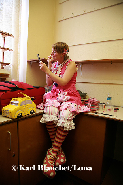 Lucy Wilkinson, alias Dr Looloo, preparing her make up in a small room next to the reception of the Royal Manchester Children hospital. The make up is very minimalist to make sure children are not scared.