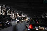 NEW YORK, NJ - DECEMBER 01: Cars move along the Ed Koch Queensboro bridge on December 01, 2018 in New York City. According to the The National Climate Assessment draws on input from 13 federal agencies, climate change will slice hundreds of billions of dollars out of the US economy. By the end of the century, climate change could cost the United States $500 billion per year.(Photo by Kena Betancur/VIEWpress)