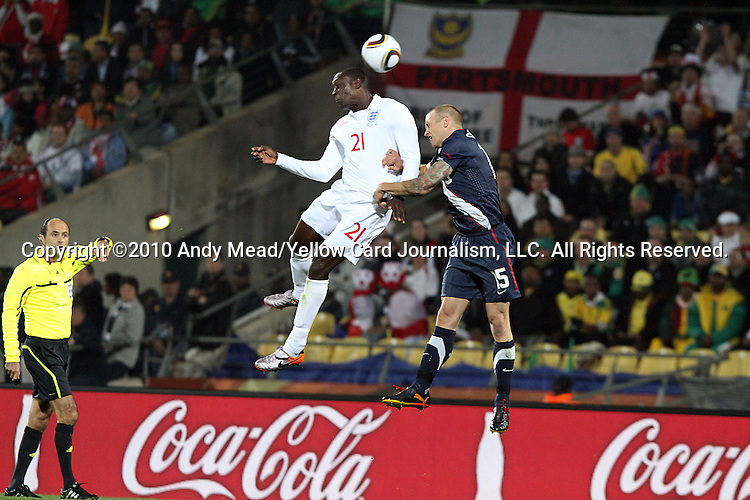 12 JUN 2010:  Emile Heskey (ENG)(21) and Jay DeMerit (USA)(15) vie for a head ball. The England National Team and the United States National Team were tied 1-1 after the first half at Royal Bafokeng Stadium in Rustenburg, South Africa in a 2010 FIFA World Cup Group C match.
