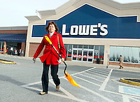 A woman buys a snow shovel in preparation for a snow in Charlottesville, Va. Photo/Andrew SHurtleff