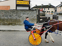 A boy rides his sulkey through Saint Marys Park Limerick.