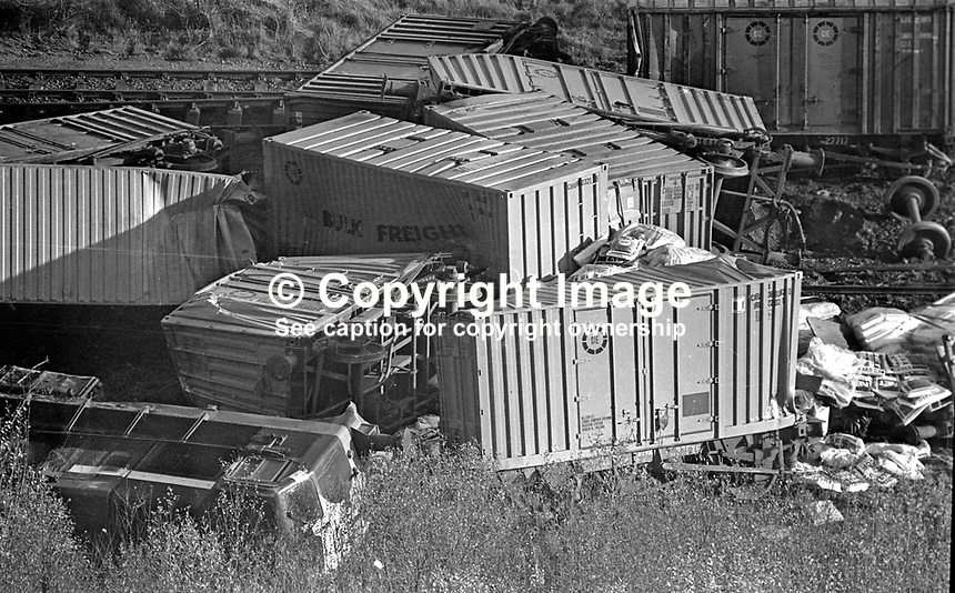 Overturned carriages on railway track at Goragh Wood, near Newry, N Ireland after the Provisional IRA hijacked and derailed the train. 197511210740b<br />