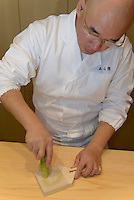 Sushi chef Mitsuhiro Araki preparing wasabi. The Araki, London, UK, December 16, 2014. Following the success of his Three-Michelin-Star restaurant in Tokyo's Ginza, in 2014 Araki relocated to London.