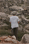 A young settler prays near the demolition site of a synagogue, in the unauthorized Israeli outpost of Tapuach West, in the West Bank. The synagogue was built in memory of the late Rabbi Meir Kahana, past-leader of the extreme Jewish rightwing, and is being demolished as part of the steps Israel takes against illegal outposts.