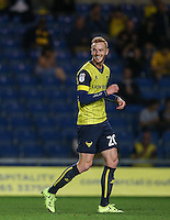 Ryan Taylor of Oxford United smiles after scoring his teams 4th goal during the The Checkatrade Trophy match between Oxford United and Exeter City at the Kassam Stadium, Oxford, England on 30 August 2016. Photo by Andy Rowland / PRiME Media Images.
