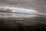 PANAMA, Bocas del Toro, clouds reflect in Almirante Bay, Central America (B&W)
