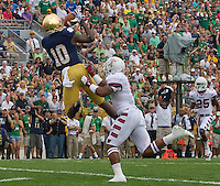 Wide receiver DaVaris Daniels (10) pulls in a Tommy Rees pass for ND's first score.