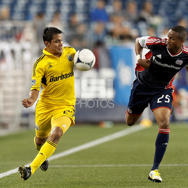 Columbus Crew forward Jairo Arrieta (25) about to win battle for ball with New England Revolution defender Darrius Barnes (25). In a Major League Soccer (MLS) match, the New England Revolution defeated Columbus Crew, 2-0, at Gillette Stadium on September 5, 2012.