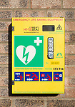 Automated External Defibrillator emergency life saving equipment mounted on wall, Community Heartbeat, Wiltshire, England, UK