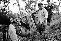 A wounded All Burma Students' Democratic Front (ABSDF) soldier being evacuated from the frontline during the second battle for Ember Hill.