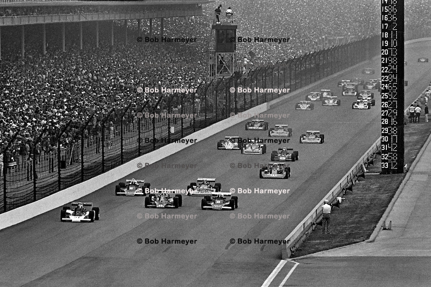 INDIANAPOLIS, IN - MAY 29: Al Unser leads the field toward Turn 1 at the start of the Indianapolis 500 on May 29, 1977, at the Indianapolis Motor Speedway in Indianapolis, Indiana.