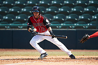 Frainyer Chavez (11) of the Hickory Crawdads lays down a bunt against the Lakewood BlueClaws at L.P. Frans Stadium on April 28, 2019 in Hickory, North Carolina. The Crawdads defeated the BlueClaws 10-3. (Brian Westerholt/Four Seam Images)