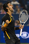 SHANGHAI, CHINA - OCTOBER 16:  Novak Djokovic of Serbia celebrates match point to Guilles Simon of France during day six of 2009 Shanghai ATP Masters 1000 at Qi Zhong Tennis Centre on October 16, 2009 in Shanghai, China.  Photo by Victor Fraile / The Power of Sport Images