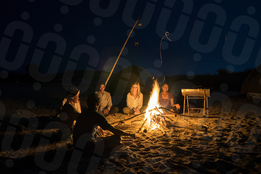 November 5, 2014 - Preah Rumkel, Stung Treng (Cambodia). Tourists enjoy the dinner on the island in front of a bone fire.