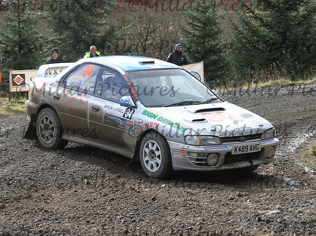 Geoff Goudie - Chris Robertson in a Subaru Impreza at Junction 8 on Special Stage 5 Buck Fell on the Brick & Steel Border Counties Rally 2014, Round 2 of the RAC MSA Scottish Rally Championship sponsored by ARR Craib Transport Limited and other championships  and organised by Whickham & District and Hawick & Border Car Clubs and based in Jedburgh and held in Kielder Forest on 22.3.14.