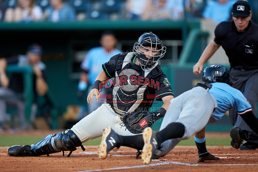 Ocelotes de Greensboro catcher Grant Koch (34) prepares to apply a tag to Miguel Aparicio (5) of the Hickory Crawdads as he approaches home plate at First National Bank Field on June 11, 2019 in Greensboro, North Carolina. The Crawdads defeated the Ocelotes 2-1. (Brian Westerholt/Four Seam Images)