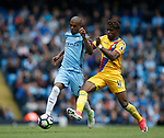 Wilfried Zaha of Crystal Palace in action with Fernandinho of Manchester City during the English Premier League match at the Etihad Stadium, Manchester. Picture date: May 6th 2017. Pic credit should read: Simon Bellis/Sportimage