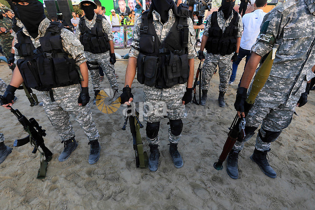 Members of Ezzedin al-Qassam brigades take part in a ceremony to honor Palestinians who were killed by Israel during the summer's fierce offensive, in Gaza city on Sep. 26, 2014. Palestinian leader Mahmoud Abbas returned to the United Nations General Assembly Friday, where he demonized Israel for the death and destruction of the 50-day summer war in Gaza and pressed for a U.N. resolution to set a deadline for Israel to pull out of Palestinian lands captured in the 1967 war. Photo by Mohammed Asad