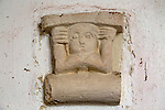 Unusual stone panel like an Aztec god, church of Saint John the Baptist, Badingham, Suffolk, England, UK