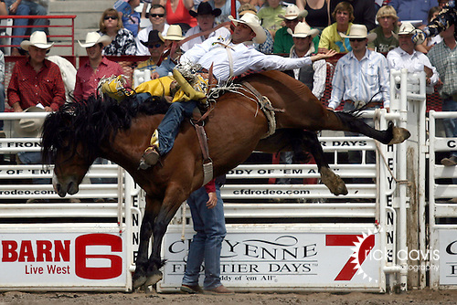 Cheyenne, Wyoming-7/26/2009-Photo by Rick Davis - Two time World Champion PRCA bareback rider Bobby Mote of Culver, Oregon, scores a thrilling 90 point bareback bronc ride on the Harry Vold bronc Dusty Dan during final round action at the 113th annual Cheyenne Frontier Days Rodeo.