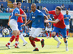 Kris Boyd and Kyle Lafferty can't get past Portsmouth defenders Sylvian Distin and Younes Kaboul