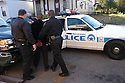 New Orleans police officers make an arrest, Nov. 20, 2003..(Cheryl Gerber photo)