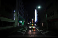 The normally bright lights of Ginza were dark six days after the huge Sendai earthquake. Ginza, Tokyo, Japan, March 16, 2011. Many people were worried about the situation at damaged nuclear plants in Fukushima.